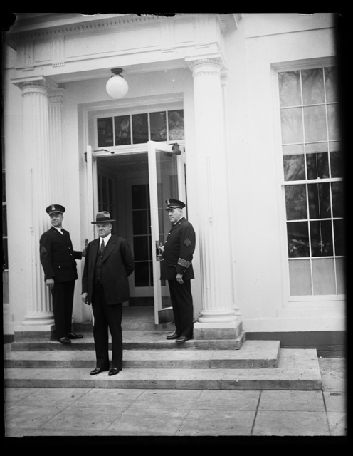 Pres. Hoover going into executive offices after remodeling