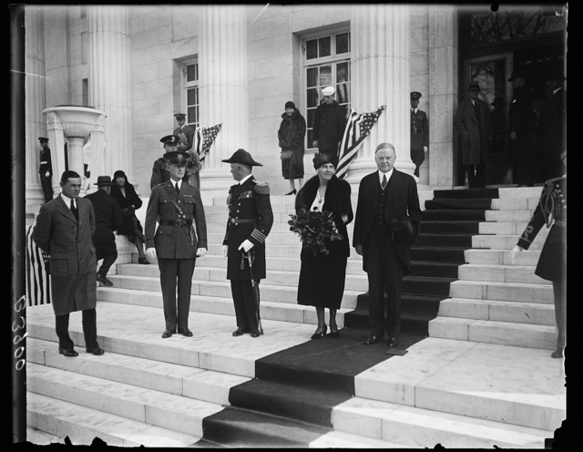President and Mrs. Hoover attend dedication of New Red Cross Building to Women of World War. President and Mrs. Hoover leaving the newest Red Cross building in Washington which was dedicated today to the women of the World War. General John J. Pershing presented the building, on behalf of the contributors, to the government