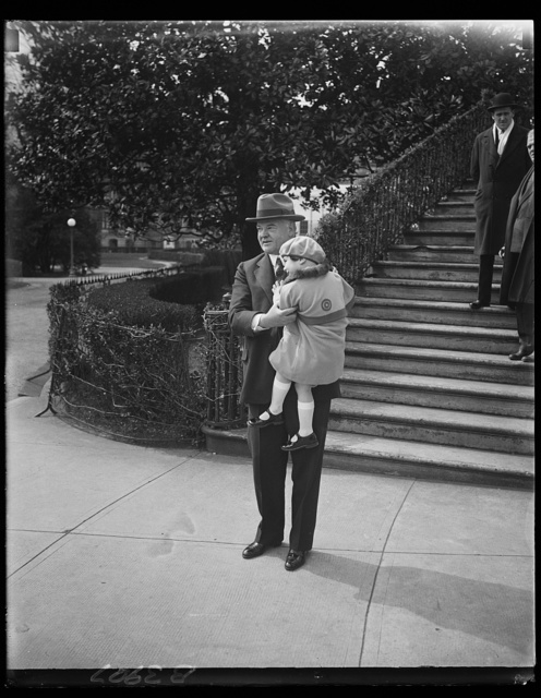 President Hoover receives first Buddy Poppy. Little Lois June Allen, five-year-old daughter of deceased veteran, presenting President Hoover with the first Buddy Poppy of the annual campaign conducted by the Veterans of Foreign Wars of the United States for the relief of disabled veterans and their dependants. The father of Lois was Private Barney Allen of Detroit, who served with the 310th Engineers in Northern Russia from July 1918 to July 1919 [White House, Washington, D.C.]