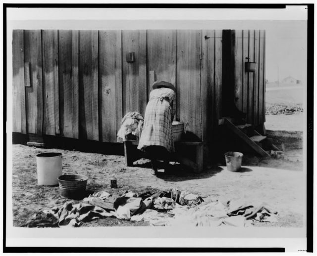 [Rear view of woman washing clothes]