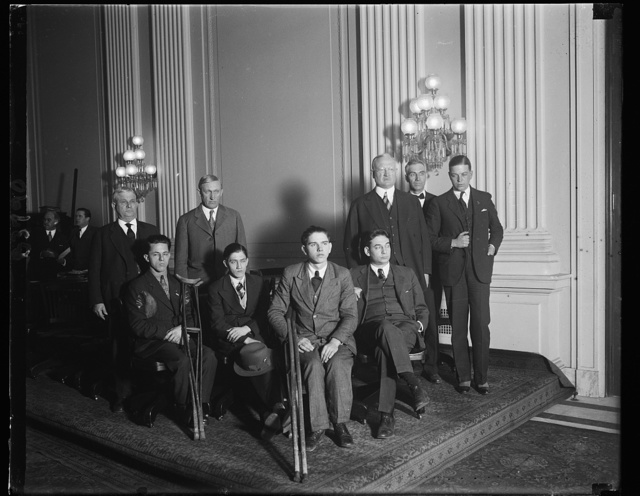 Rehabilitation hearing. The House Committee on Education met today in the House Caucus room to consider a bill presented by Mr. Reed of New York to provide ]à] the promotion of vocational rehabilitation of persons disabled in industry or otherwise and then returned to civil employment. Several crippled boys were present with some of their handiwork. Left to right, standing: Representatives D.D. Glover of Arkansas, W.P. Lamberton of Kansas, La Fayette L. Patterson of Alabama, Paul J. Kvale of Minnesota, Daniel A. Reed of New York