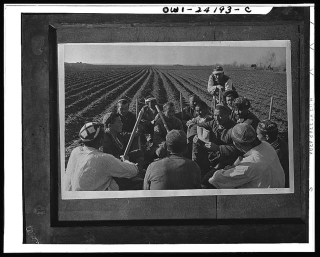 Uzbek collective farmers discussing work of spring sowing in the USSR (Union of Soviet Socialist Republics)