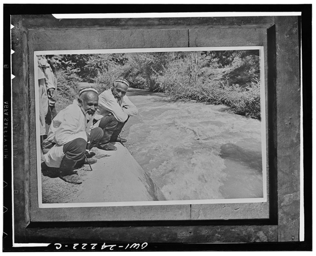 Uzbek collective farmers watching the first waters of Syr-Darya river enter the sluices of the great Fergana canal which they helped to build. This canal irrigates the huge new cotton growing areas of Central Asia in the USSR (Union of Soviet Socialist Republics)