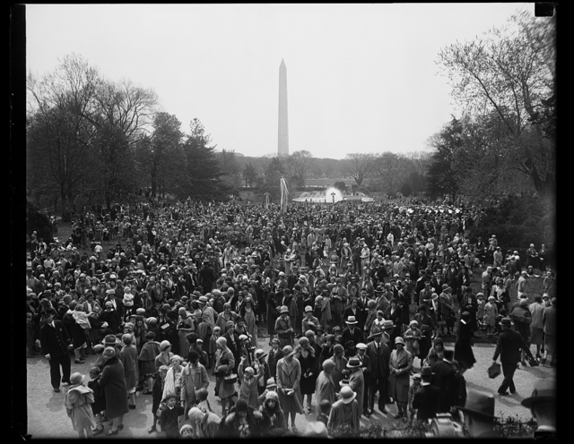 Washington children roll Easter eggs on White House lawn. Scene on the south lawn of the White House where today where thousands of Washington children rolled their Easter eggs. The Washington monuments can be seen in the background