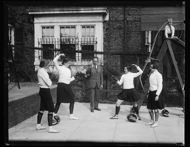 Washington society girls compete for fencing title. These Washington society girls will compete for fencing title of the District of Columbia at the Mayflower Hotel this week. In the photograph, left to right: Elizabeth Bunting, judge; Pricilla Holcombe; Maj. Walter E. Blunt, referee; Margaret Montgomery; and Lillian Shuman, Judge