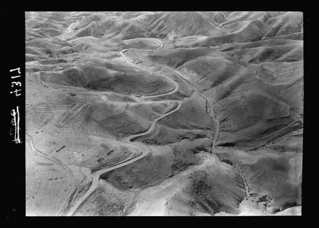 Air views of Palestine. Air route following the old Jerusalem-Jericho Road. Jericho Road via Neby Mousa [i.e, Nebi Musa]. The new Wady Iktaif Road
