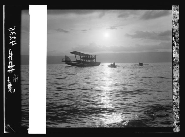 """Air views of Palestine. Aircrafts etc. of the Imperial Airways Ltd., on the Sea of Galilee and at Semakh. Flying boat """"Satyrus."""" Anchored before Tiberias. Moonlight"""