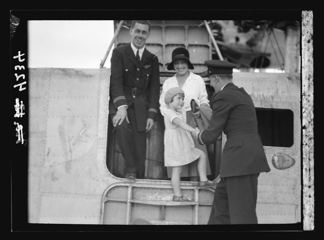 Air views of Palestine. Aircrafts etc. of the Imperial Airways Ltd., on the Sea of Galilee and at Semakh. Flying boat's first passenger alighting. Little Miss Pamela Cross helped out by flying officers