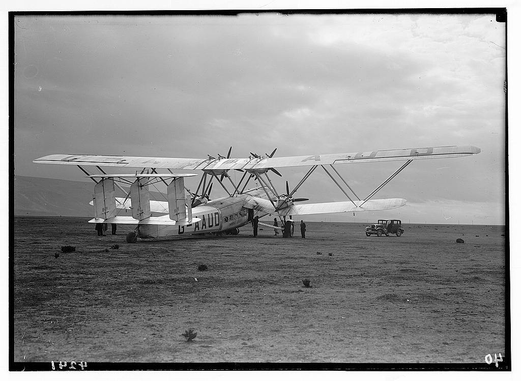 """Air views of Palestine. Aircrafts etc. of the Imperial Airways Ltd., on the Sea of Galilee and at Semakh. Aircraft """"Hanno"""" ready for take-off. Silver wings against dark clouds at Semakh"""