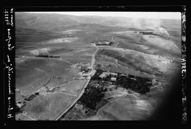 Air views of Palestine. Jerusalem from the air. Various on Scopus and Olivet. Jerusalem. The Hebrew University. Looking W. along the Olivet road. War cemetery in distance