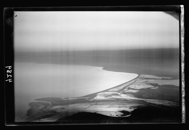 Air views of Palestine. North end of Dead Sea. Dead Sea. Northern end. An evening silhouette. Showing salt pans