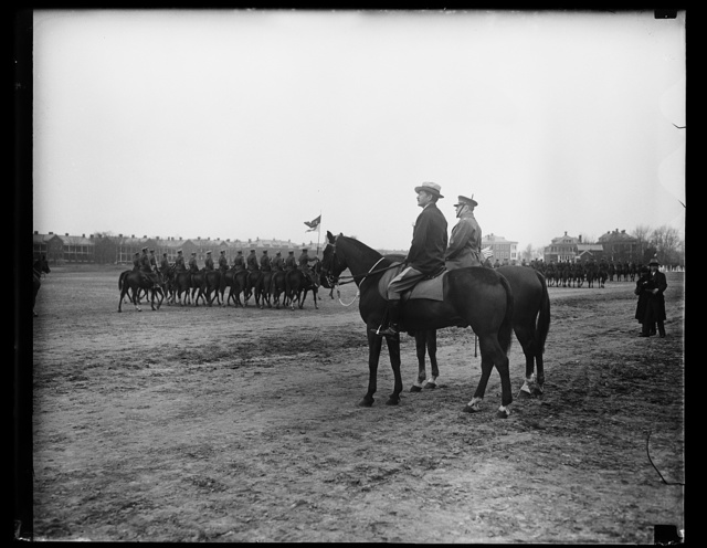 [Cavalry; Patrick J. Hurley on horsback in foreground]