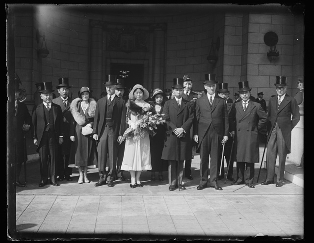 [Charles Adams and Henry L. Stimson with group of Japanese? visitors at Union Station, Washington, D.C.]