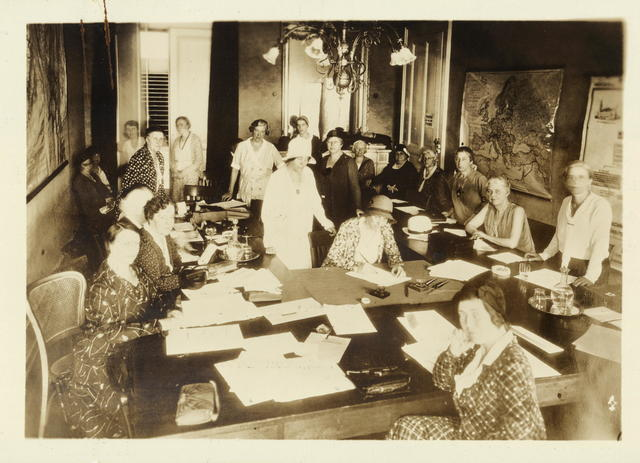 Doris Stevens working with Women's Consultative Committee at League of Nations, ca. 1931. Alice Paul is standing behind Stevens in the center.