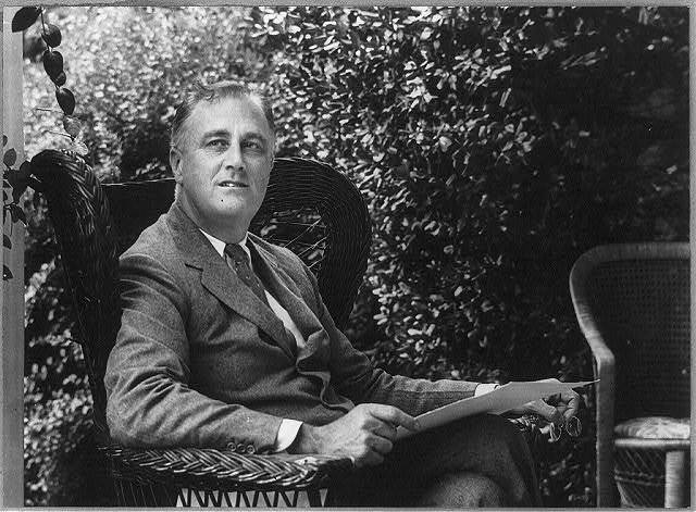 [Franklin D. Roosevelt, three quarters length portrait, seated on porch, facing right]