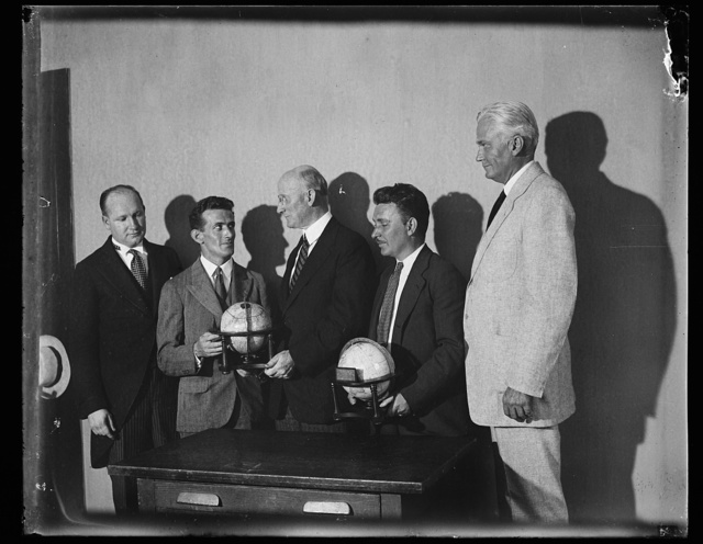 [Group with globes: Robert P. Lamont, 3rd from right; Hiram Bingham, right]