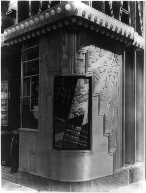 [Inset billboard at corner of Trans-lux Theatre, 58th St., and Madison Ave., New York City]