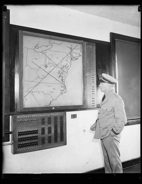 [Man in uniform viewing map of Mid-Atlantic]