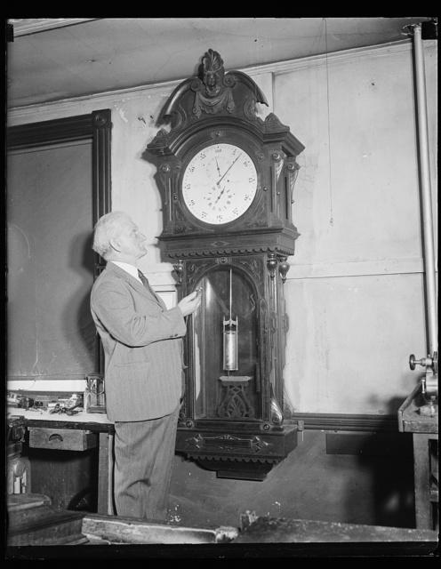 [Man with clock]