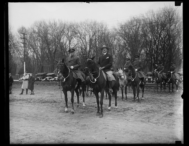 [Men on horseback; Patrick J. Hurley, center]