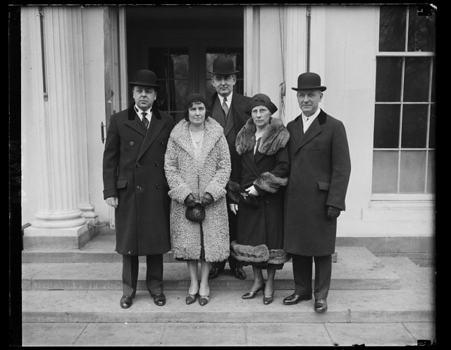 Mich. Gov. and Atty. Gen. of Michigan received by Pres. Hoover. L to r: Gov. Brucker, Mrs. Brucker, Sen. Vandenberg, Mrs. Paul Vorhees, and Atty. Gen. Paul Vorhees [White House, Washington, D.C.]