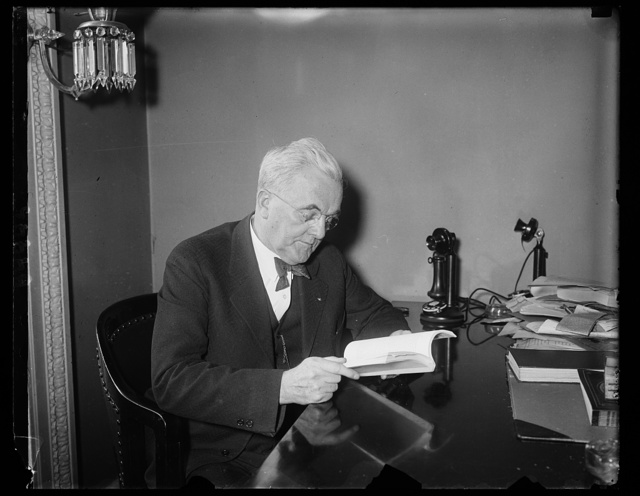 Senators go in for heavy reading. Members of the Senate are doing some serious and extensive reading these days, in studying the report of President Hoover's Commission on Law Enforcement, better known as the Wickersham Report. The photograph shows Sen. George W. Norris of Nebraska, chairman of the Senate Judiciary Committee which will consider the report, trying to find out what it is all about, 1/23/31