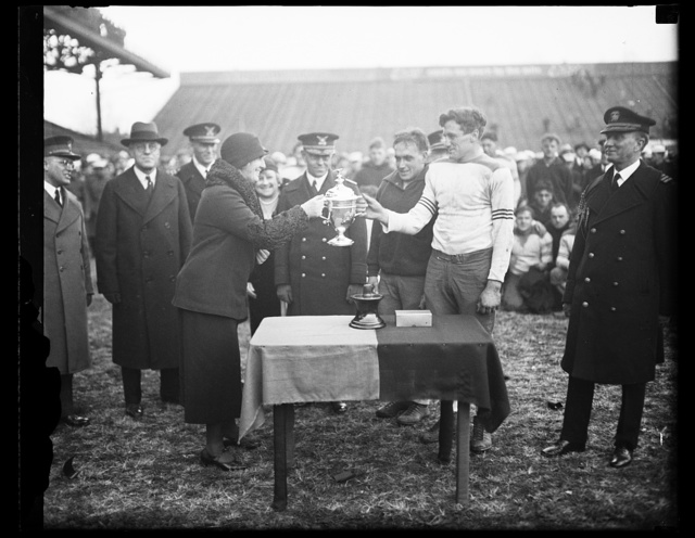 [Trophy cup at football game (Army-Navy game?)]