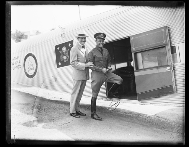 [Unidentified at door to airplane with presidential emblem]