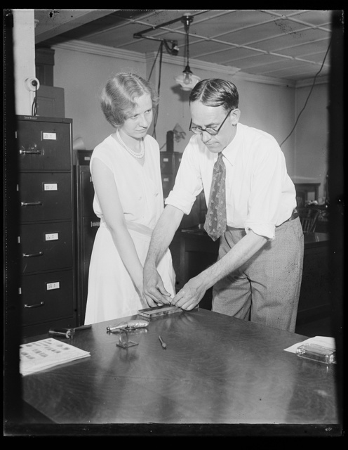 [U.S. Worker finger printed. Starting in July, all civil service employees of the United States government will have their finger prints recorded for purpose of identification. Miss Opal Boyce, employee of the civil service department, is shown having her fingerprints made by John H. Clark, assistant chief of the civil service identification bureau, 7/1/31]