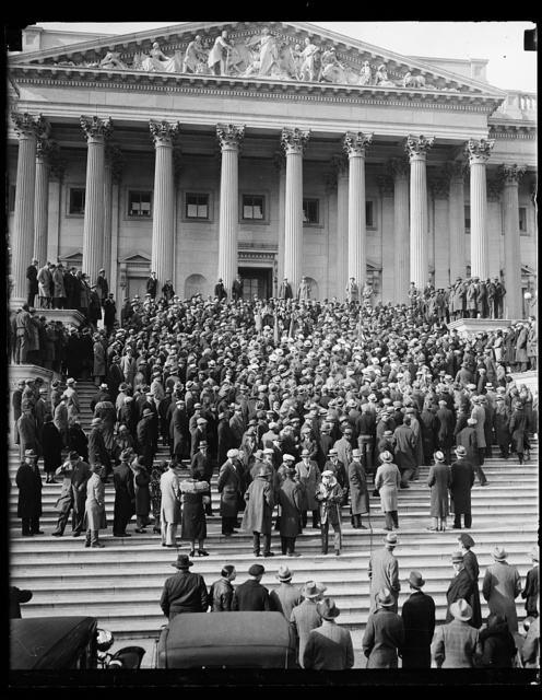 Vets protest bonus bill delay. Protesting Congress' delay in considering the soldiers' cash bonus proposal, scores of Washington veterans paraded to the Capitol in a demonstration to seek immediate action. They were met on the Capitol steps by members of the House who are war veterans, where the photograph shows them being addressed by Rep. [...] Patman of Texas. 1/31
