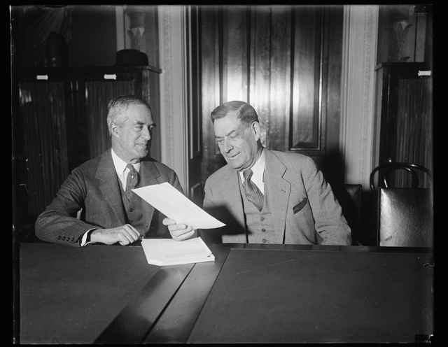Woods testifies on unemployment. Col. Arthur Woods, Chairman of President Hoover's Emergency Employment Committee, testified before the Senate Appropriation Committee that unemployment in the United States had doubled since the census report of April 1, and that the total is now between 4,000,000 and 5,000,000. He predicted that the situation will not improve until spring and declared that unemployment and poverty are directly responsible for prevailing crime. At Wood's right is Sen. Wesley L. Jones, chairman of the Senate Committee. 1/7/31