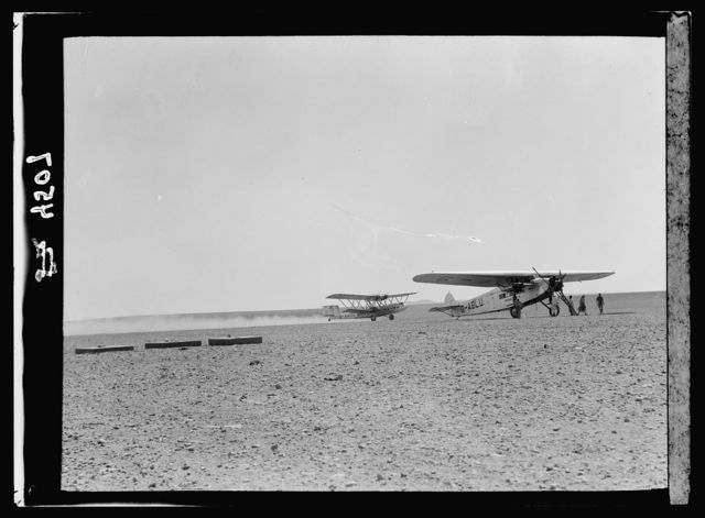 "Air route to Baghdad via Amman and the desert. Aircrafts ""Hanno"" and ""Apollo"" at Rutba. The former taking off, leaving a tail of desert dust"