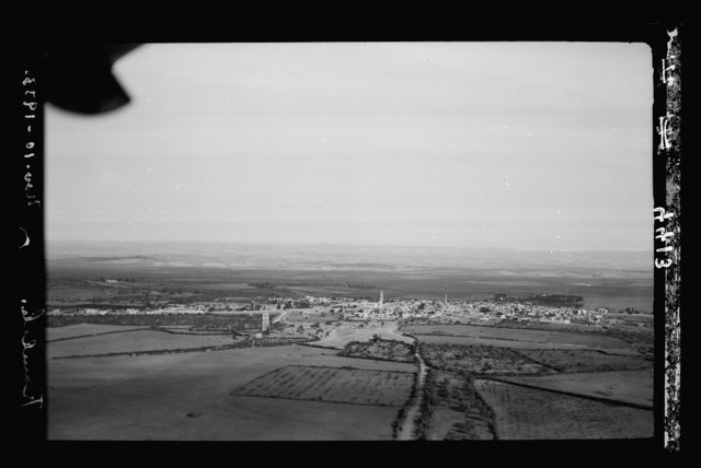 """Air views of Palestine. Air route over Cana of Galilee, Nazareth, Plain of Sharon, etc. Ramleh. Arimathea. A general view showing the Saracenic tower of """"forty martyrs"""""""