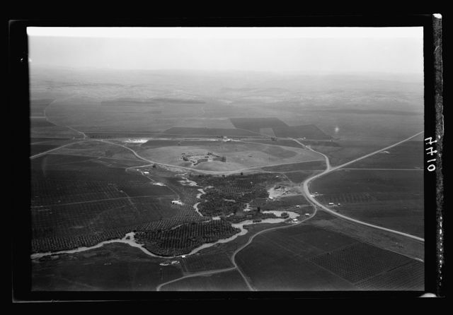 Air views of Palestine. Air route over Cana of Galilee, Nazareth, Plain of Sharon, etc. Ras el-Ain. Source of the Auji showing the old caravansary of Antipatris