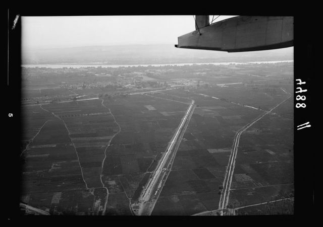 Air views of Palestine. Flight down the delta of the Nile to Alexandria. Gardens and Nile irrigation canals. Pyramids seen in far distance