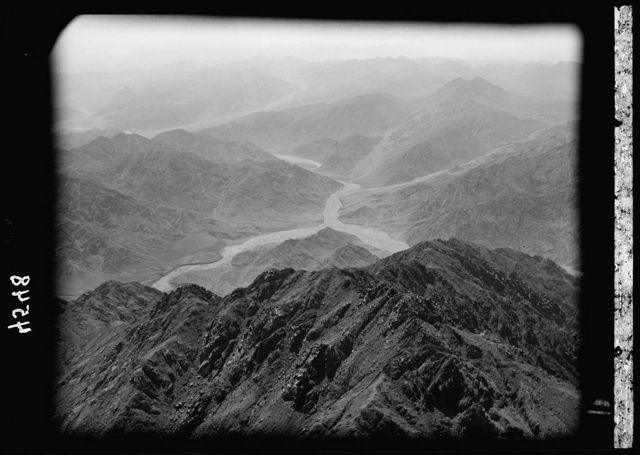 Air views of Palestine. Flight to Ma'an el-Hadj, Petra, Wadi Rum and Akaba. Wady Rum District. View looking eastward showing mountainous country E. of Akaba