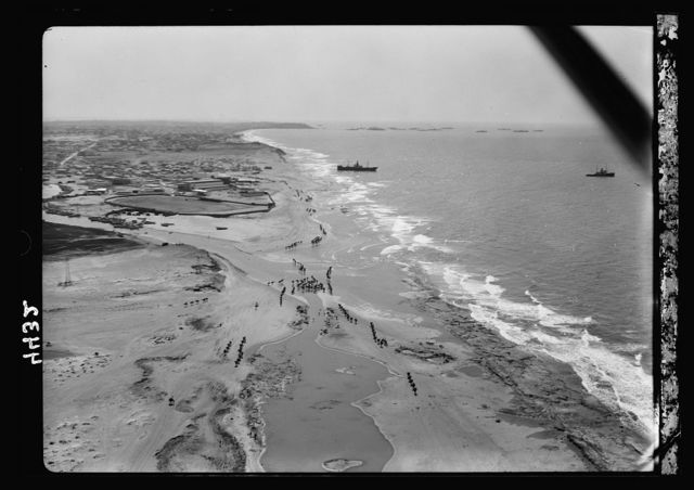 Air views of Palestine. Jaffa, Auji River and Levant Fair. Breakers along the northern coast. Jaffa promontory in far distance looking S.