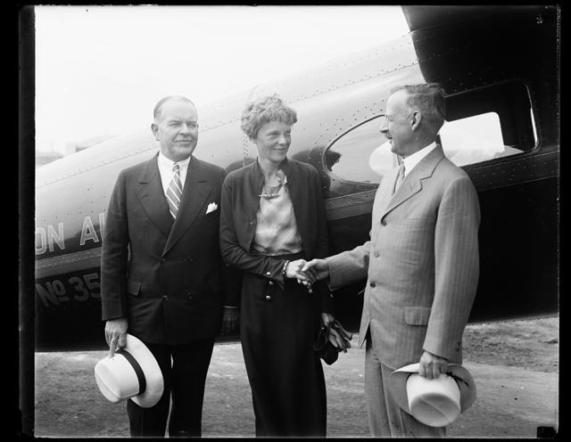 [Amelia Earhart, center]