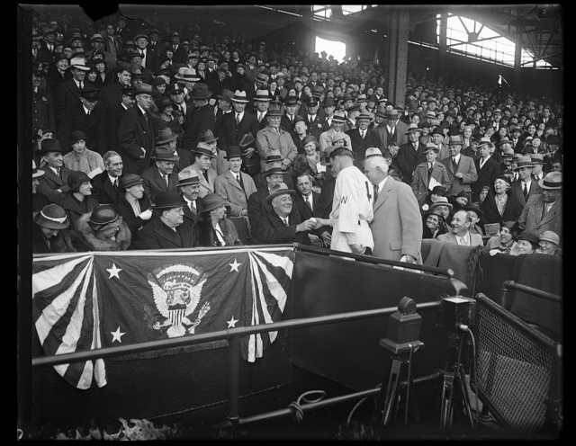 [Eleanor Roosevelt and Franklin Roosevelt at Washington baseball game]