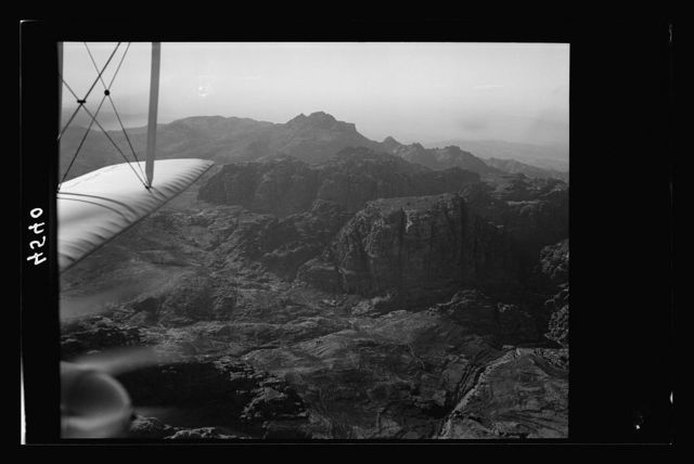 Flight to Ma'an el-Hadj, Petra, Wadi Rum and Akaba. Umm el-Biyara. In foreground is the junction of Wadis el-Thughra and el-Farasa, on horizon Neby Hârùn. Wadi Araba in far distance
