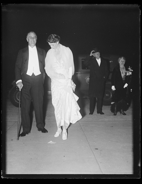 [Franklin Roosevelt (standing with cane) and Eleanor Roosevelt]