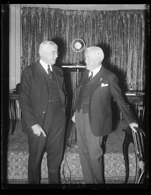 Gov. Albert C. Ritchie of Maryland and John W. Davis of West Virginia, talking things over at the lower right