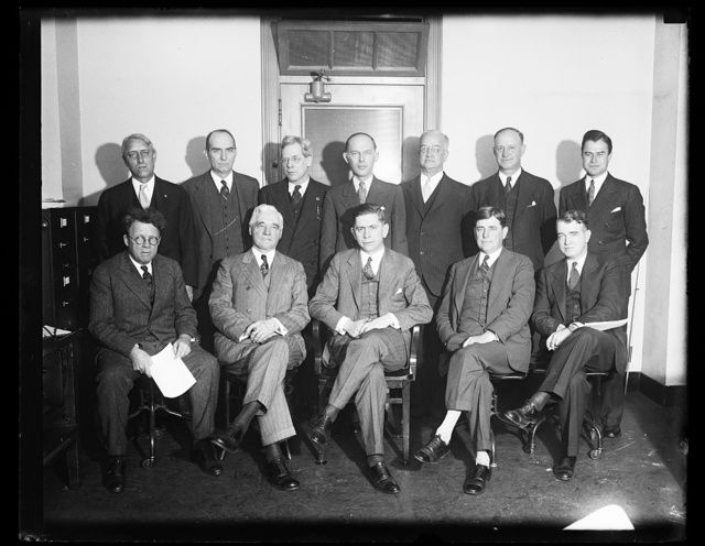 [Group: Edward Stettinius, Jr., front row, 2nd from left]