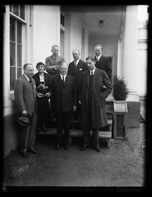 [Herbert Hoover with group at White House; Ray Wilbur, right front]