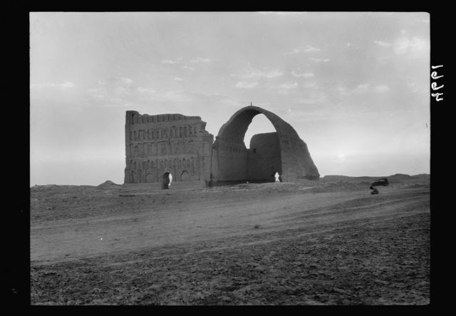 """Iraq. Arch of Ctesiphon. """"The wonder arch of the east."""" Sunset effect from the E."""