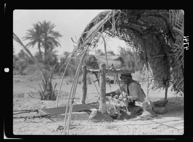 Iraq. Kifl. Native Moslem [i.e., Muslim] village with a Jewish shrine to the prophet Ezekiel. Native weaver. At work on his loom