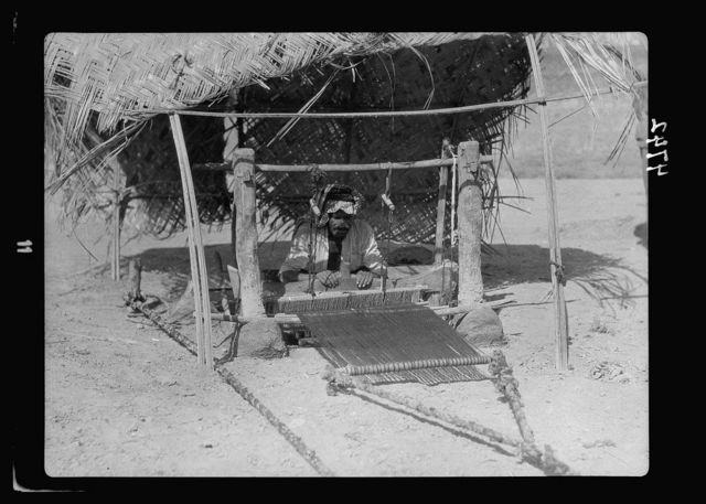 Iraq. Kifl. Native Moslem [i.e., Muslim] village with a Jewish shrine to the prophet Ezekiel. At work on his loom. Front view