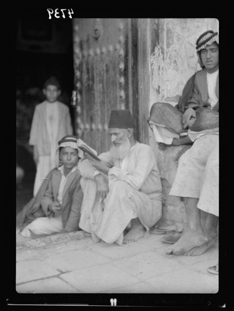 Iraq. Kifl. Native Moslem [i.e., Muslim] village with a Jewish shrine to the prophet Ezekiel. Jewish rabbi reading. At the entrance to the shrine