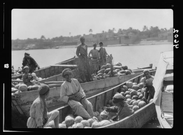 Iraq. (Mesopotamia). Baghdad. River scenes on the Tigris. Barges of watermelons with typical Iraqi boys