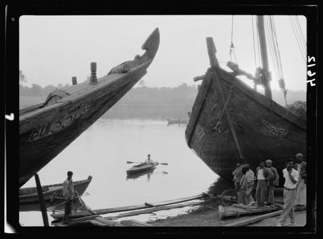 "Iraq. (Mesopotamia). Baghdad. River scenes on the Tigris. The Tigris. Characteristic bows of the ""Bellums."" Large river boats with ornamental bows"